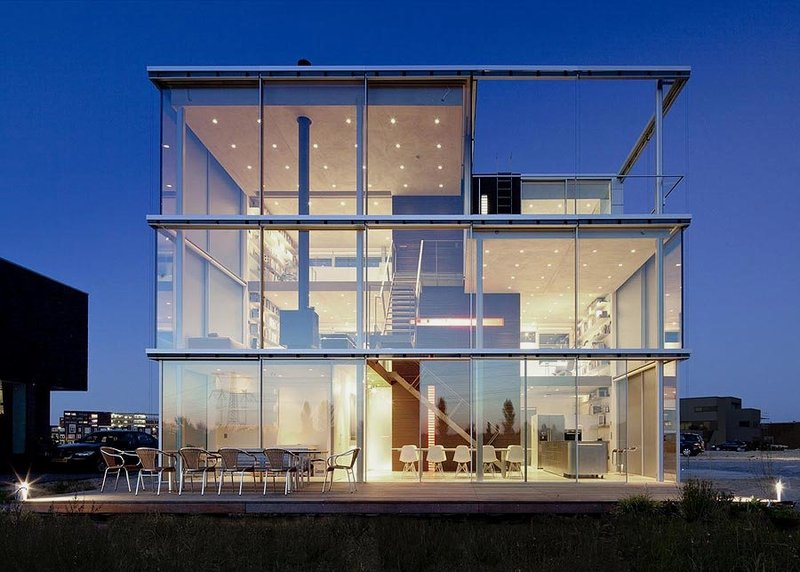 back-view-of-Modern-House-with-Big-Open-Views-Trough-Glass-Wall